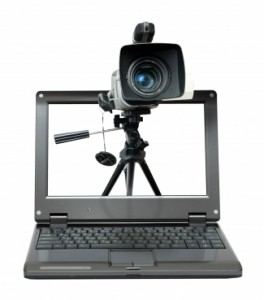 video marketing: laptop with camera tripod