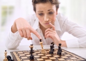 business woman playing chess