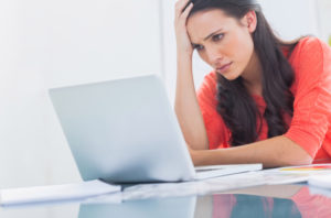 stressed out woman at laptop